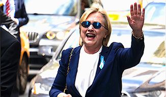 "Hillary Clinton waves to confirm she was feeling better on Sunday after leaving the 9/11 anniversary ceremony in New York early due to feeling ""overheated."" (Associated Press)"