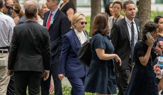 Diagnosis: Hillary Clinton nearly fainted at a 9/11 commemoration event in New York Sunday. Her campaign then said she was suffering from pneumonia. (Associated Press)