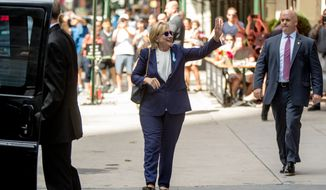 "Democratic presidential candidate Hillary Clinton waves as she leaves an apartment building Sunday, Sept. 11, 2016, in New York. Clinton's campaign said the Democratic presidential nominee left the 9/11 anniversary ceremony in New York early after feeling ""overheated."" (AP Photo/Andrew Harnik)"