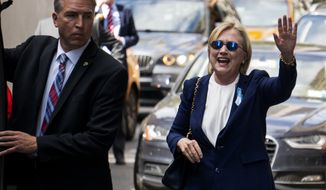 """Democratic presidential candidate Hillary Clinton waves as she walks from her daughter's apartment building Sunday, Sept. 11, 2016, in New York. Clinton unexpectedly left Sunday's 9/11 anniversary ceremony in New York after feeling """"overheated,"""" according to her campaign. (AP Photo/Craig Ruttle)"""