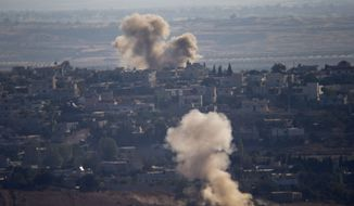 Smoke and explosions from the fighting between forces loyal to Syrian President Bashar Assad and rebels rise in the village of Jubata al-Khashab as seen from the Israeli-controlled Golan Heights, Sunday, Sept. 11, 2016. (AP Photo/Ariel Schalit)