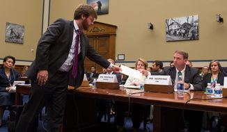 Jason Herring, acting Assistant Director for Congressional Affairs at the FBI, is served a subpoena to provide the full investigative file during the House Committee on Oversight and Government Reform hearing on classifications and redactions in the FBI's investigative file of former Secretary of State Hillary Clinton's private server. (Associated Press)