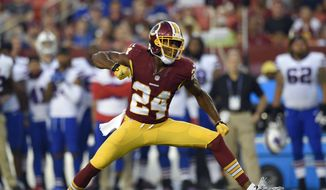 FILE - In this Aug. 26, 2016, file photo, Washington Redskins cornerback Josh Norman (24) reacts after a play during the first half of an NFL preseason football game against the Buffalo Bills in Landover, Md. After signing a $75 million, 5-year deal, the spotlight is on Norman. who is expected to match up significantly against Antonio Brown of the Pittsburgh Steelers on Monday night, Dez Bryant of the Dallas Cowboys in Week 2 and rival Odell Beckham Jr. of the New York Giants in Week 3.  (AP Photo/Nick Wass, File)