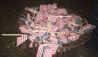 Officials at Occidental College in Los Angeles are investigating the vandalism of a student group's 9/11 memorial in which nearly 3,000 U.S. flags were uprooted and trashed. (Facebook/@Occidental College Republican Club)