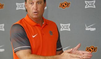 Oklahoma State coach Mike Gundy speaks during media availability for the NCAA college football team at Boone Pickens Stadium in Stillwater, Okla., Monday, Sept. 12, 2016. (Nate Billings/The Oklahoman via AP)