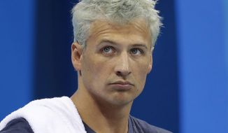 """FILE - In this Aug. 9, 2016, file photo, United States' Ryan Lochte prepares before a men's 4x200-meter freestyle heat at the 2016 Summer Olympics, in Rio de Janeiro, Brazil. Lochte says he feels """"a little hurt"""" after being involved in an incident on """"Dancing with the Stars"""" that prompted producers to cut to a commercial. The beleaguered swimmer was apparently rushed by unknown people while receiving his scores from Judge Carrie Ann Inaba on the Monday, Sept. 12, 2016, live installment of the celebrity ballroom dance competition. (AP Photo/Michael Sohn, File)"""
