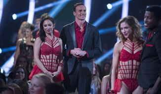 """In this photo provided by ABC, Cheryl Burke, left, and Ryan Lochte, center, appear on """"Dancing with the Stars,"""" competition that begins with the two-hour season premiere live, Monday, Sept. 12, 2016, on the ABC Television Network. (Eric McCandless/ABC via AP)"""