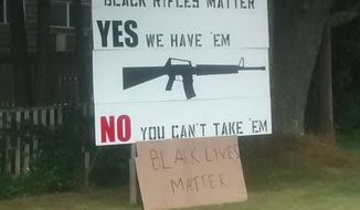 "Maine resident Linc Sample posted an image online of a ""Black Rifles Matter"" sign he erected on his property, which was apparently vandalized. (Facebook)"