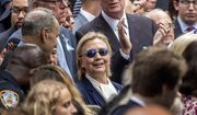 In this Sept. 11, 2016, photo, Democratic presidential candidate Hillary Clinton, center, accompanied by Sen. Chuck Schumer, D-N.Y., left, Rep. Joseph Crowley, D-N.Y., second from left at top, and New York Mayor Bill de Blasio, center top, attends a ceremony at the Sept. 11 memorial, in New York. Clinton will be back on the campaign trail Thursday, after spending several days at home recovering from pneumonia. (AP Photo/Andrew Harnik)
