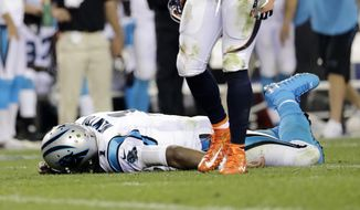 FILE - In this Sept. 8, 2016, file photo, Carolina Panthers quarterback Cam Newton (1) lies on the turf after a roughing the passer penalty was called on Denver Broncos free safety Darian Stewart (26) during the second half of an NFL football game in Denver. s some Broncos players prepare to face the financial consequences of their helmet-to-helmet hits on Cam Newton, they insist they're not a dirty defense, although they don't really mind if that's their reputation. (AP Photo/Joe Mahoney, File) **FILE**