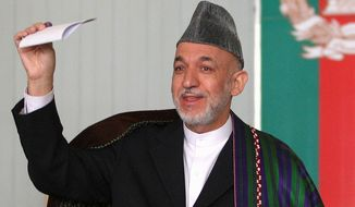 As president of Afghanistan, Hamid Karzai destroyed a corruption investigation into a man believed to have smuggled out of the country as much as $2.78 billion for Afghan officials, drug traffickers and insurgents. (Associated Press)