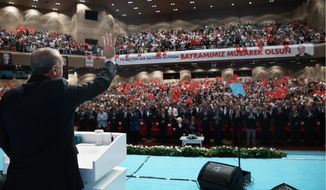 Turkish President Recep Tayyip Erdogan is riding a wave of nationalism in order to brand his critics as enemies of the state. Dissenters fear Mr. Erdogan may sponsor a crackdown after a failed military coup over the summer. (ASSOCIATED PRESS)