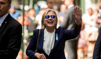 """In this Sept. 11, 2016, file photo, Democratic presidential candidate Hillary Clinton waves after leaving an apartment building in New York. Hillary Clinton's doctor says she is recovering from her pneumonia and remains """"healthy and fit to serve as President of the United States."""" The statement was part of medical information Clinton's campaign released Wednesday, Sept. 14, 2016, after her pneumonia diagnosis last week. (AP Photo/Andrew Harnik, File)"""
