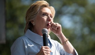 Hillary Clinton stops her speech to cough at Luke Easter Park in Cleveland, Ohio, on Sept. 5. (Associated Press)