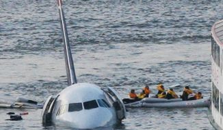 In this Jan. 15, 2009, file photo, passengers in an inflatable raft move away from an Airbus 320 US Airways aircraft that has gone down in the Hudson River in New York. More than seven years after an airline captain saved 155 lives by ditching his crippled airliner in the Hudson River, now the basis of a new movie, most of the safety recommendations stemming from the accident have yet to be followed. (AP Photo/Bebeto Matthews, File)