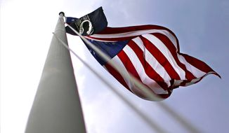 A POW-MIA flag and Old Glory fly above the grounds of the Fayetteville Veterans Affairs Medical Center in Fayetteville, N.C. (AP Photo/Patrick Semansky) ** FILE **