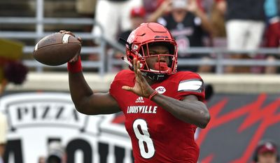 Louisville quarterback Lamar Jackson looks for a receiver during the first quarter of an NCAA college football game against Florida State, Saturday, Sep. 17, 2016 in Louisville Ky. (AP Photo/Timothy D. Easley)