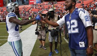 Dallas Cowboys wide receiver Dez Bryant (88) greets Washington Wizards point guard John Wall before an NFL football game against the Washington Redskins in Landover, Md., Sunday, Sept. 18, 2016. (AP Photo/Alex Brandon)