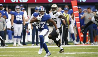New York Giants wide receiver Sterling Shepard (87) runs away from New Orleans Saints' Ken Crawley (46) during the second half of an NFL football game Sunday, Sept. 18, 2016, in East Rutherford, N.J.  (AP Photo/Kathy Willens) **FILE**