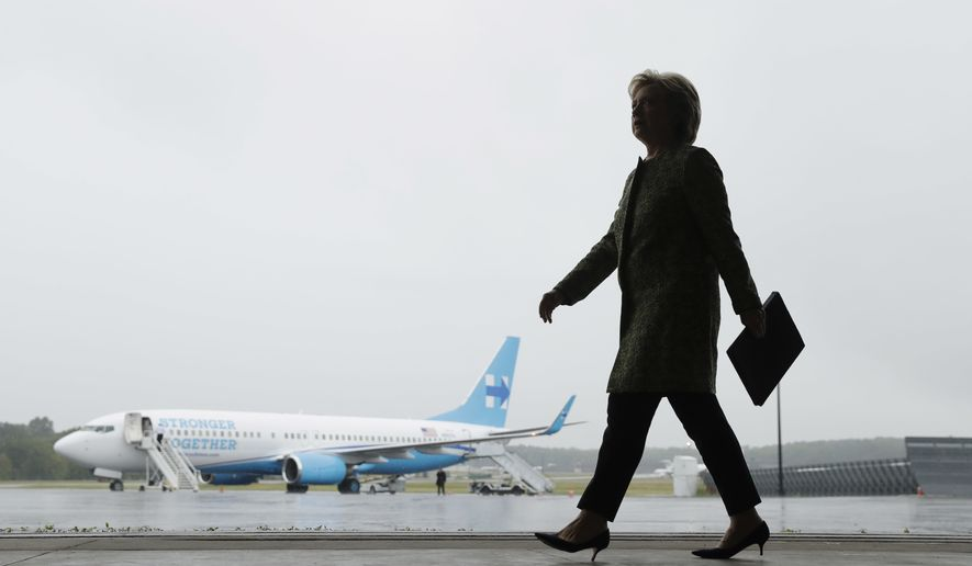 Democratic presidential candidate Hillary Clinton walks to a podium to speak with members of the media at Westchester County Airport in White Plains, N.Y., Monday, Sept. 19, 2016. (AP Photo/Matt Rourke)