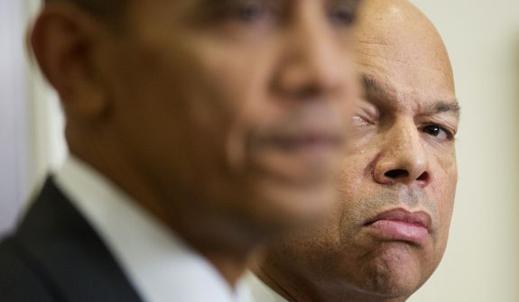 Homeland Security Secretary Jeh Johnson listens at right as President Obama speaks in the Roosevelt Room of the White House in Washington on Nov. 25, 2015. (Associated Press) **FILE**