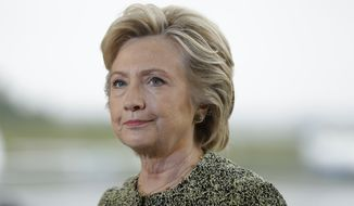 Democratic presidential candidate Hillary Clinton speaks with members of the media at Westchester County Airport in White Plains, N.Y., Monday, Sept. 19, 2016. (AP Photo/Matt Rourke)
