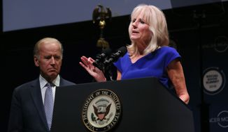 United States Vice President Joe Biden looks on as his wife Dr. Jill Biden speaks about Cancer Moonshot, an initiative to advance scientific research for cancer, at The Social Good Summit at the 92nd Street Y in New York, Monday, Sept. 19, 2016. (Stuart Ramson/AP Images for UN Foundation) ** FILE **