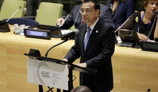 Premier of the People's Republic of China Li Keqiang addresses the United Nations Summit for Refugees and Migrants, in the Trusteeship Council Chamber of the United Nations, Monday, Sept. 19, 2016. (AP Photo/Richard Drew)