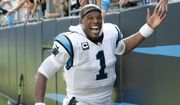 Carolina Panthers' Cam Newton (1) celebrates with fans following an NFL football game against the San Francisco 49ers in Charlotte, N.C., Sunday, Sept. 18, 2016. The Panthers won 46-27.  (AP Photo/Bob Leverone)