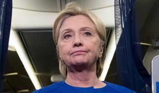 Democratic presidential candidate Hillary Clinton pauses while she remarks on the explosion in Manhattan's Chelsea neighborhood onboard her campaign plane at Westchester County Airport, in White Plains, N.Y., Saturday, Sept. 17, 2016. (AP Photo/Andrew Harnik)