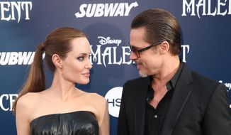 "In this May 28, 2014, file photo, Angelina Jolie and Brad Pitt arrive at the world premiere of ""Maleficent"" in Los Angeles. Angelina Jolie Pitt has filed for divorce from Brad Pitt, bringing an end to one of the world's most star-studded, tabloid-generating romances. An attorney for Jolie Pitt, Robert Offer, said Tuesday, Sept. 20, 2016, that she has filed for the dissolution of the marriage. (Photo by Matt Sayles/Invision/AP, File) **FILE**"