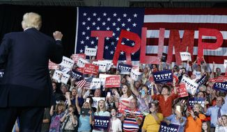 Supporters cheer as Republican presidential candidate Donald Trump arrives to speak to a campaign rally, Tuesday, Sept. 20, 2016, in Kenansville, N.C. (AP Photo/ Evan Vucci)