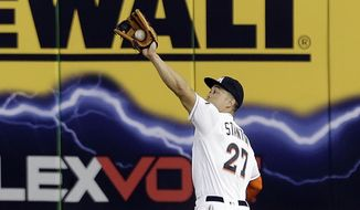 Miami Marlins right fielder Giancarlo Stanton catches a fly ball by Washington Nationals' fClint Robinson in the fifth inning of a baseball game, Tuesday, Sept. 20, 2016, in Miami. (AP Photo/Alan Diaz)