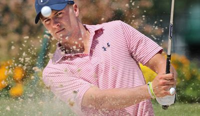 Tour Championship golf tournament defending champion Jordan Spieth hits sand shots to the practice green while preparing to defend his title at East Lake Golf Club in Atlanta,  on Tuesday, Sept. 20, 2016, (Curtis Compton/Atlanta Journal-Constitution via AP)
