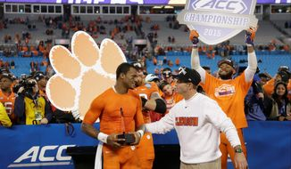 Quarterback Deshaun Watson (left), coach Dabo Swinney and the defending ACC champion Clemson Tigers may have an inside track in the Atlantic Division race, but the biggest question looming over the league is the site of this year's title game. (Associated Press)