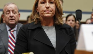 Mylan CEO Heather Bresch pauses as she prepares to testify on Capitol Hill in Washington, Wednesday, Sept. 21, 2016, before the House Oversight Committee hearing on EpiPen price increases. Bresch defended the cost for life-saving EpiPens, signaling the company has no plans to lower prices despite a public outcry and questions from skeptical lawmakers. (AP Photo/Pablo Martinez Monsivais)
