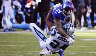 FILE - In this Dec. 20, 2015, file photo, New York Giants wide receiver Odell Beckham (13) and Carolina Panthers' Josh Norman (24) grapple during the first half of an NFL football game in East Rutherford, N.J. Whether the receiver and Norman, now a Redskins cornerback, can play nice on the field Sunday when Washington comes to MetLife Stadium for an NFC East rivalry game remains to be seen. (AP Photo/Julie Jacobson, File) **FILE**