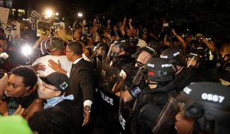 Charlotte police encountering protesters earlier in the week.           Associated Press photo