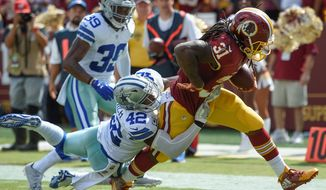 The Washington Redskins only gave the ball once to running back Matt Jones in six goal-to-go offensive opportunities in Sunday's loss to the Dallas Cowboys. (Associated Press)