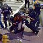 A protester, center, is taken into custody by Charlotte-Mecklenburg police officers in Charlotte, N.C., Wednesday, Sept. 21, 2016. Authorities in Charlotte tried to quell public anger Wednesday after a police officer shot a black man, but a dusk prayer vigil turned into a second night of violence, with police firing tear gas at angry protesters and a man being critically wounded by gunfire. North Carolina's governor declared a state of emergency in the city. (Jeff Siner/The Charlotte Observer via AP)