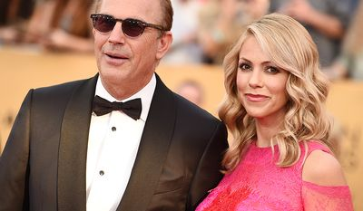 Kevin Costner was born 22 years before his wife Christine Baumgartner (AP Photo)