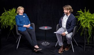 "In this undated image released by FunnyorDie.com, Democratic presidential candidate Hillary Clinton, left, appears with actor-comedian Zach Galifianakis during an appearance for the online comedy series, ""Between Two Ferns."" (FunnyorDie.com via AP)"
