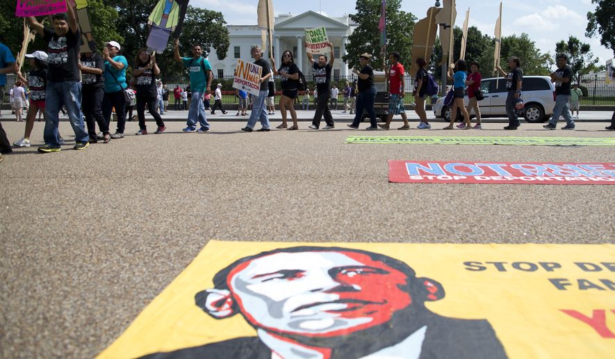 Demonstrators rally in front of the White House in Washington on July 24, 2013, in favor of immigration reform. (Associated Press) **FILE**
