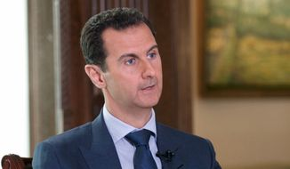 In this Wednesday, Sept. 21, 2016, photo released by the Syrian Presidency, Syrian President Bashar Assad speaks to The Associated Press at the presidential palace in Damascus, Syria. Assad said U.S. airstrikes on Syrian troops in the country's east were definitely intentional, lasting for an hour, and blamed the U.S. for the collapse of a cease-fire deal brokered with Russia. (Syrian Presidency via AP)