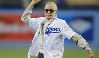 Comic book writer Stan Lee throws the ceremonial first pitch before a baseball game between the Los Angeles Dodgers and the Colorado Rockies, Thursday, Sept. 22, 2016, in Los Angeles. (AP Photo/Jae C. Hong)