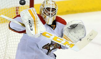 FILE - In this March 1, 2016, file photo, Florida Panthers goaltender Roberto Luongo makes a blocker save against the Winnipeg Jets during the third period of an NHL hockey game in Winnipeg, Manitoba. Luongo, who was expected to need up to six months to recover from a May surgery to repair a tear in one of his hips, is ahead of the original schedule and cleared to be on the ice when the reigning Atlantic Division champions hold their first practice of camp on Friday, Sept. 23, 2016 (Trevor Hagan/The Canadian Press via AP, File)