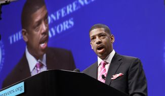 In this June 23, 2014 file photo, Sacramento, Calif., Mayor Kevin Johnson, president of the U.S. Conference of Mayors, speaks before a panel discussion about sports and race relations during a conference meeting in Dallas. A man hit Mayor Johnson in the face with a pie at a charity dinner. The mayor's Chief of Staff Crystal Strait called the Wednesday night, Sept. 21, 2016, incident at the Sacramento Charter High School a shocking assault, but said the mayor wasn't hurt. (AP Photo/LM Otero, File)