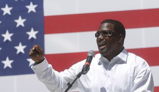 In this on Aug. 20, 2015 photo, Illinois Sen. Napoleon Harris, D-Harvey, speaks to supporters during a Democrats Day rally at the Illinois State Fair in Springfield, Ill. (AP Photo/Seth Perlman)