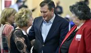 Sen. Ted Cruz, Texas Republican, talks with Cathie Adams, past president of Texas Eagle Forum, at the annual Grassroots America We The People Champions of Freedom award dinner Friday. Mr. Cruz announced he will vote for Donald Trump. (Associated Press)