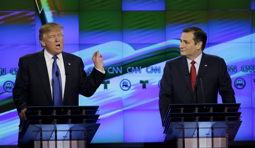 In this Feb. 25, 2016, file photo, Sen. Ted Cruz, R-Texas listen as Donald Trump speaks during a Republican presidential primary debate at The University of Houston in Houston. (AP Photo/David J. Phillip, File)